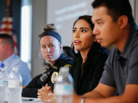 Officer Sarah Smith, second from right, speaks while