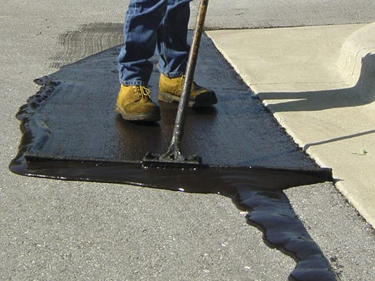 Coal tar is applied to asphalt to seal it.  Springfield Striping & Sealing no longer uses a coal tar product.