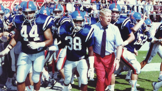 Chucky Mullins (38) prepares to lead Ole Miss onto the field. Standing next to him is head coach Billy Brewer - Ole Miss File Photo