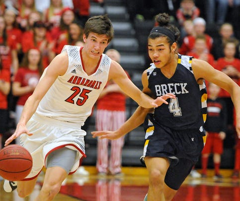 Chase Knickerbocker of Annandale drives with the ball against Brett Wadman of Breck during Friday's Section 5-2A playoff game at Halenbeck Hall in St. Cloud.