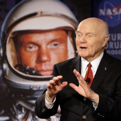 U.S. Sen. John Glenn talks with astronauts on the International