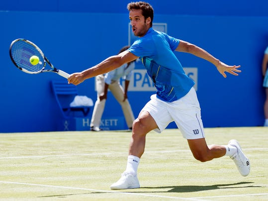 Spain's Feliciano Lopez in action against Serbia's Dusan Lajovic at the Queen's Club grass-court tournament in  London Tuesday June 10, 2014. (AP PhotoJonathan Brady/PA) UNITED KINGDOM OUT