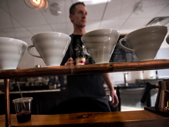 Kyle Goldberg, founder of Gold Ladder Coffee off Susie Wilson Road in Essex Junction next to the Bagel Cafe, has been been blending and roasting coffee for years and is introducing cold coffee, served up from a keg through a nitro tap, something that - until now - you had to go to a big city to find.
