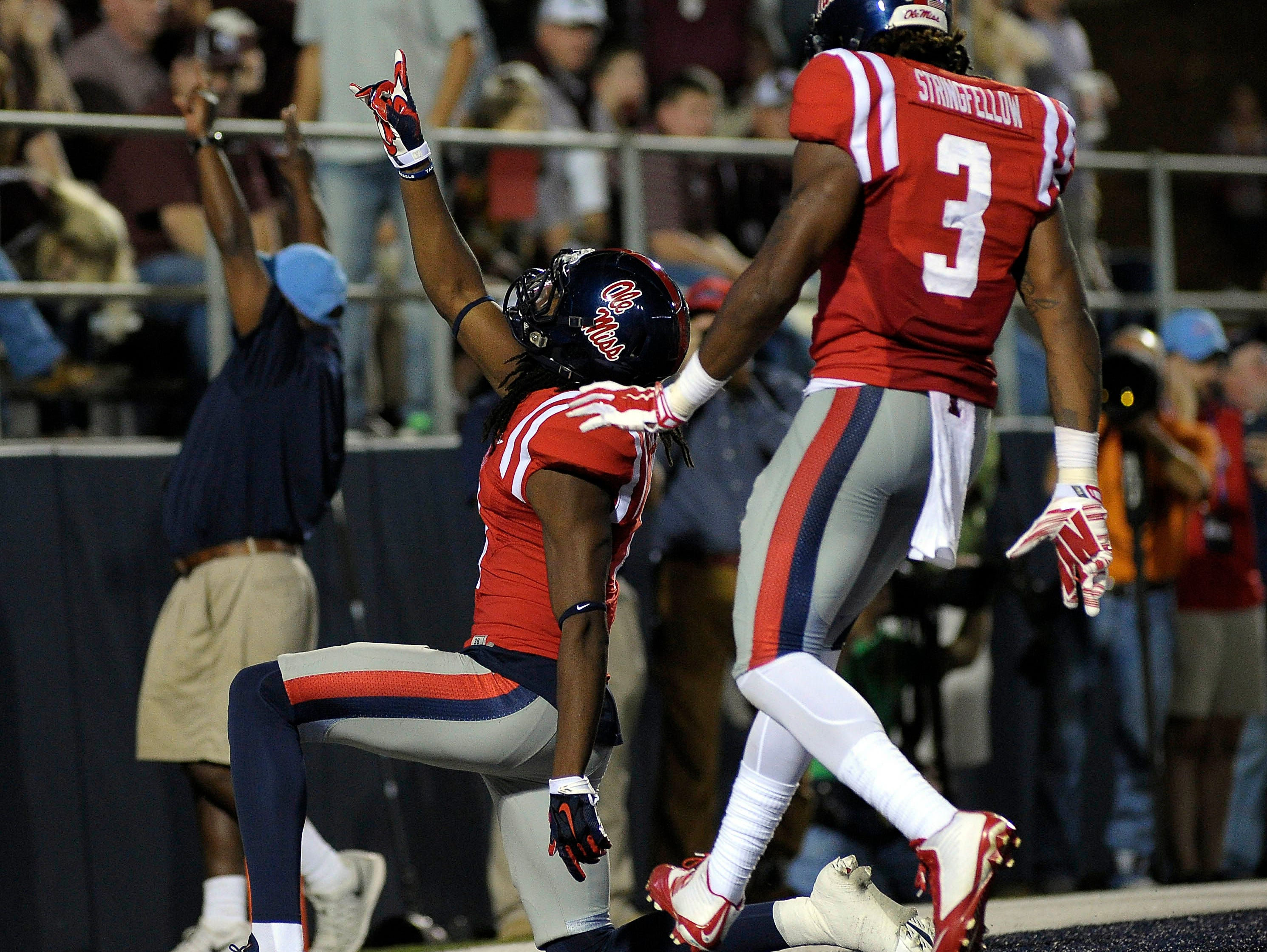Ole Miss wide receiver Laquon Treadwell (left) is excited to play Auburn again. He suffered a left leg injury in last year's game against the Tigers.