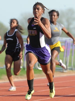 Byrd's Morgan White takes the lead in the 100 meter dash during the District 1-5A track meet at Benton High on April 24.