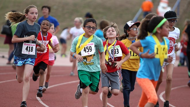 Students from Kindergarten through sixth grade to participate in the final .2 miles lap of a 26 mile marathon around the San Angelo Stadium track Thursday, April 6, 2017. The seventh annual CATCH in Motion Kids Marathon was hosted by Shannon Medical Center.