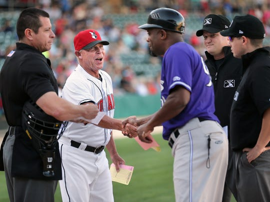 Tribe Manager Dean Treanor shakes hands with Louisville