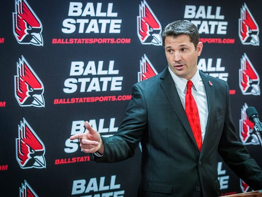 Mike Neu speaks during a press conference at Worthen