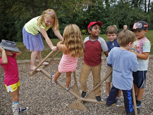 Kids play during their short 15-minute recess at Cherry