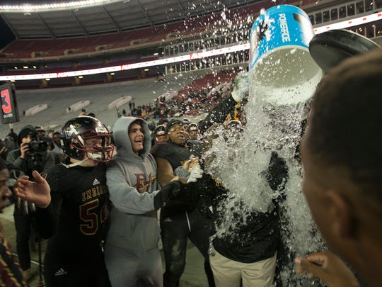 Pinson Valley coach Patrick Nix is dunked after the AHSAA Class 6A Football State Championship on Friday, Dec. 8, 2017, in Tuscaloosa, Ala. Pinson Valley defeated Wetumpka 31-10.