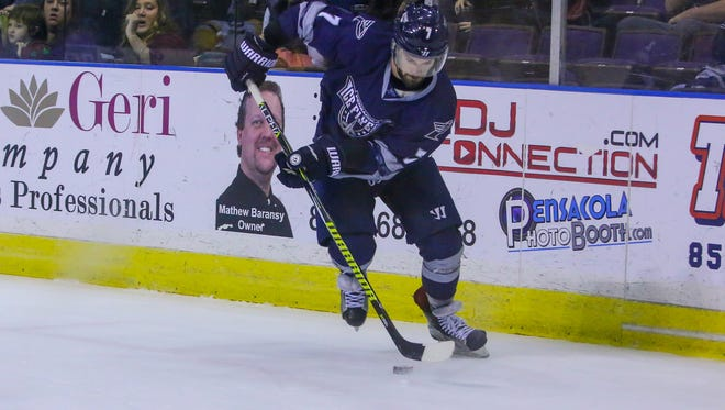 Pensacola's Josh Cousineau (7) skates into the Mississippi zone at the Pensacola Bay Center on Tuesday, December 26, 2017. The Ice Flyers won 2-0.