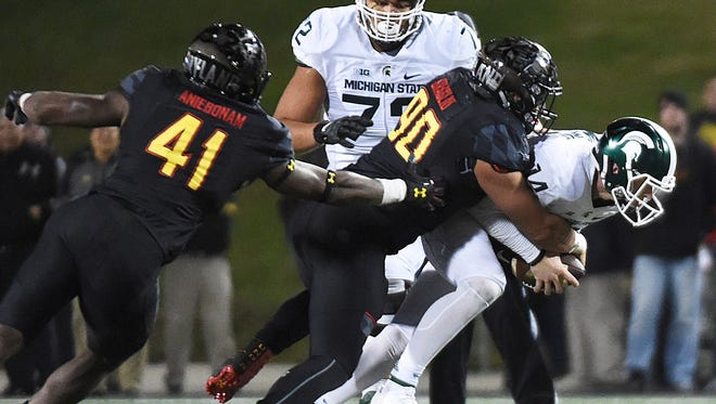 Brian Lewerke is sacked by Maryland's Roman Braglio in the second half Saturday night.