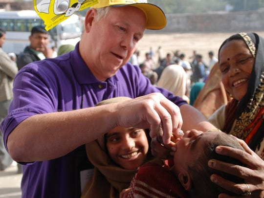 Tom Guyette, foundation chairman of the Rotary Club of Green Bay, provides the polio vaccine in India.