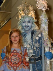 Olivia Benitez, 9, takes a photo op with Jack Frost