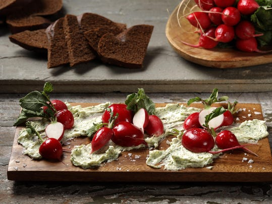 Herb-flecked butter makes rich contrast to bite of radishes