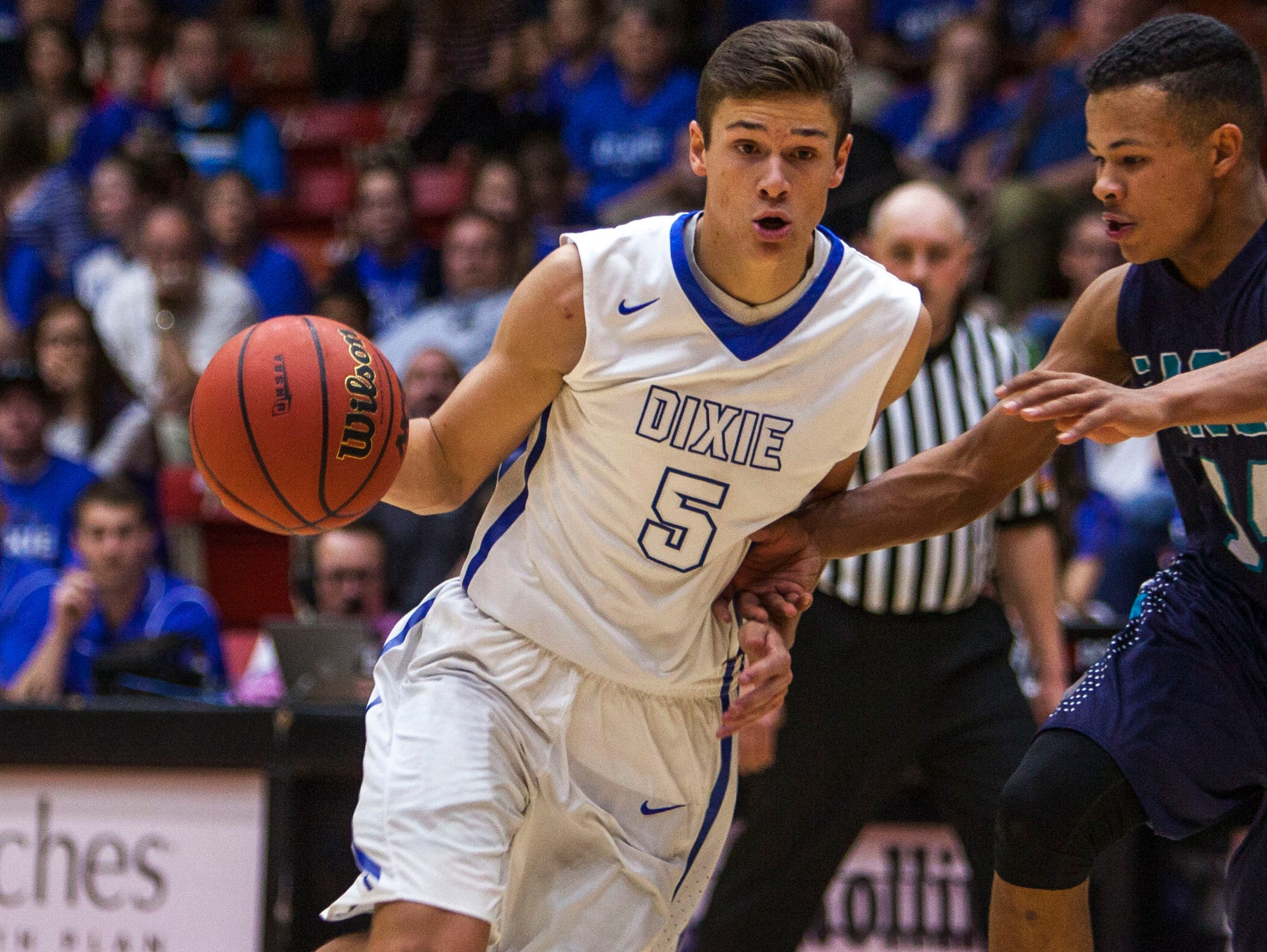 Dixie's Tyler Bennett drives the ball towards the basket during the game against Juan Diego in Saturday's 3A championship at the SUU Centrum, Feb. 27, 2016.
