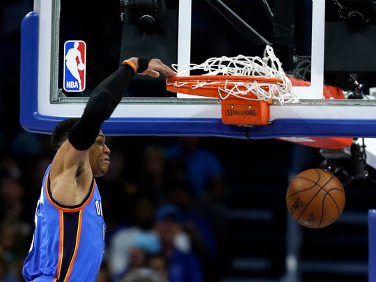 Oklahoma City Thunder's Russell Westbrook dunks the ball against the Orlando Magic during the second half of an NBA basketball game, Wednesday, March 29, 2017, in Orlando, Fla. Oklahoma won 114-106 in overtime. Westbrook scored 57 points in a triple double.