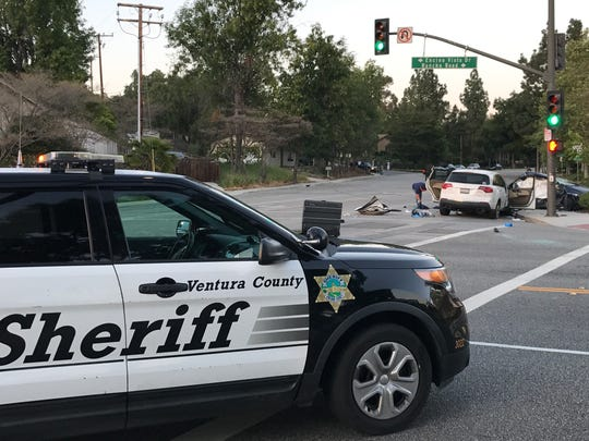 Authorities investigate a crash at Hillcrest Drive and Rancho Road that killed two men Thursday in Thousand Oaks.