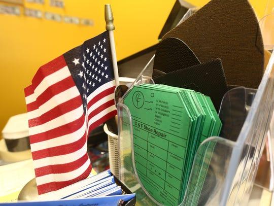 Repair tags at C&F Shoe Repair in the City of Poughkeepsie