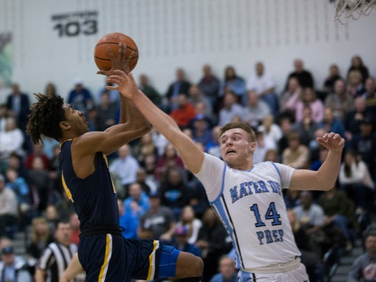 Mater Dei's Kyle Cardaci tries to block shot by Toms River North's Darrion Carrington during second half action. Toms River North vs Mater Dei in Shore Conference Boys Basketball Semifinal in Toms River on February 21, 2017.