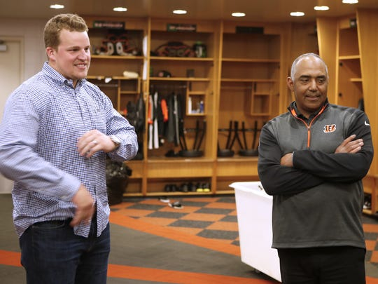 Bengals' Clint Boling, left, and head coach Marvin Lewis talk to the media after the team re-signed the starting left guard. The team also introduced A.J. Hawk, the former Ohio State and Green Bay linebacker, who signed with the team Wednesday.