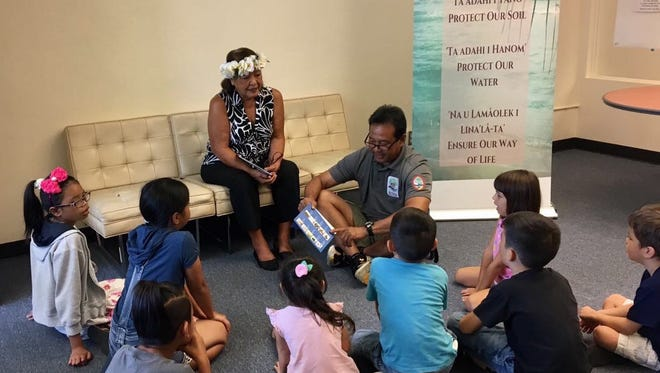 """In this file photo, the Guam Soil and Water Conservation Districts hosted a book reading of """"Apu and Isa Learn to Conserve"""" and a native guasali planting event at the Nieves F. Flores Hagåtña Memorial Library."""