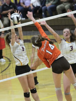 Lexington's Oliva Kearns goes for the block in Saturday's Division II regional championship volleyball match with Padua at Lexington.