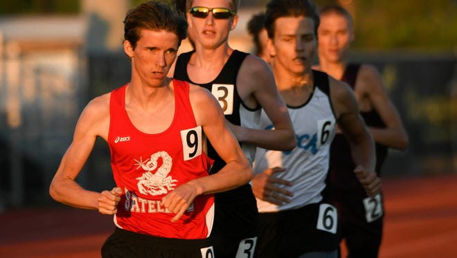 Satellite's Trevor Kattenburg leads the way in the 1600 during the Cape Coast Conference track meet Thursday.
