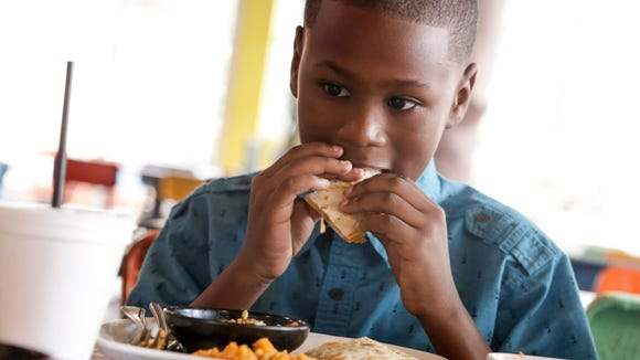 Nine-year-old food critic Kelon George at Agave in downtown Lafayette March 1, 2017.
