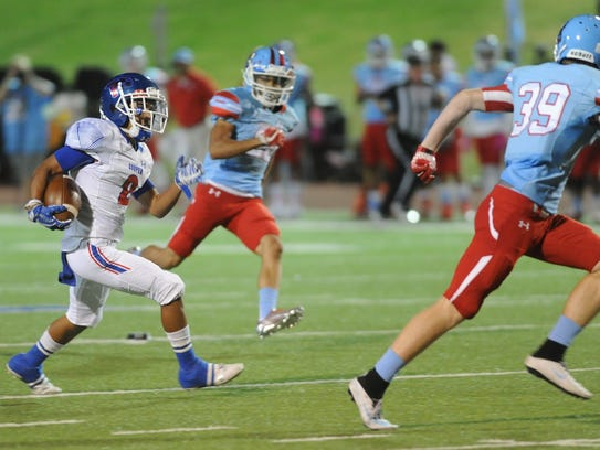 Cooper's Daelin Campos, left, looks for running room