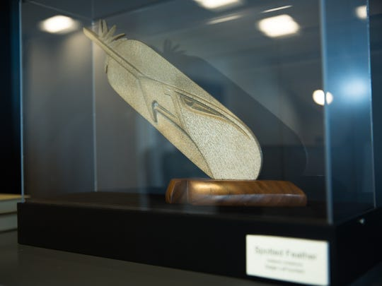 "Saige LaFountain's Indiana limestone piece ""Spotted Feather"" is showcased in a glass box at Burrell College of Osteopathic Medicine."