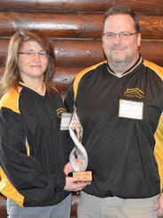 Jon and Tina Griesbach hold the 2016 Small Business