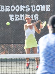 Sophie Woorons, returns a ball to Jennifer Adams of Anderson during a tennis lesson at Brookstone Meadows in Anderson. She and her father Lucien Woorons won a national title as a Super Senior father-daughter doubles team on clay court in Florida.