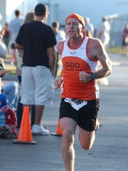 Estero cross country coach Jeff Sommer competes in