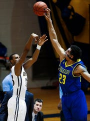Delaware forward Skye johnson blocks a shot attempt by Drexel's Rashann London in the second half of the Blue Hens' 74-64 loss at the Daskalakis Athletic Center in Philadelphia, Pa.