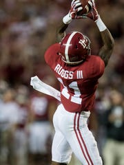 Alabama wide receiver Henry Ruggs III (11) catches