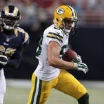 Green Bay Packers wide receiver Jeff Janis, right, sprints past St. Louis Rams defensive tackle Deantre Harlan after catching a pass and running it in for a touchdown during the third quarter of an NFL preseason football game Aug. 16. Janis is hoping to make the Packers final 53-man roster this week. (AP Photo/Tom Gannam)