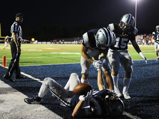 Farragut's Braden Collins (23) is picked up by teammates after scoring a touchdown during a high school football game at Farragut against Oak Ridge, Friday, Sept. 8, 2017.