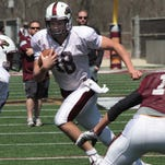 Quarterback Daniel Fitzwater (18) finds room to run during ULM's spring football game.