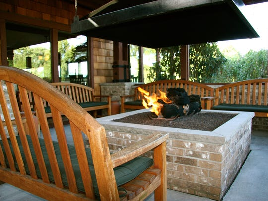 Warm up at Salt Creek Grille's outdoor fireplace, which