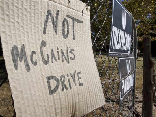 A sign posted on a Page Springs Road fence near U.S.