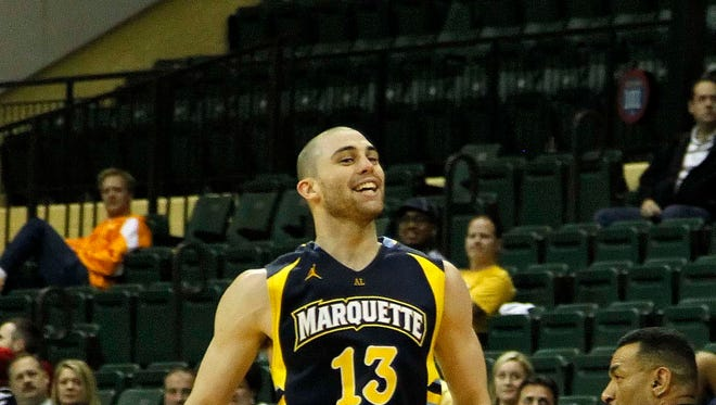 Marquette Golden Eagles guard Matt Carlino (13) reacts after he shot a three pointer against the Georgia Tech Yellow Jackets during the second half at HP Field House. Marquette Golden Eagles defeated the Georgia Tech Yellow Jackets 72-70.
