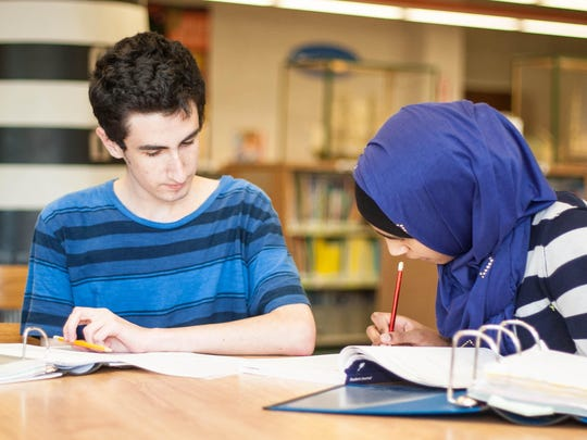 Homework Helper Josh Reich, left, tutors middle-school student Sarah Siddiqi, 12, with her geometry homework at the Monmouth County Library in Manalapan.