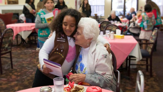 Girl Scouts of the Desert Southwest visited elderly residents of the Aristocrat Assisted Living Center on Tuesday to spread Valentine's Day cheer.