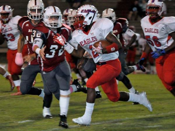 Jaden Gardner, No. 2 of the Pine Forest Eagles, finds some running room around the end of the Tate Aggies defense during first-half action in their game Friday night at Tate High.
