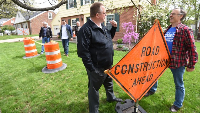 Eric Miller, far right, invited community leaders including Mansfield City Schools' Superintendent Brian K. Garverick to his home Saturday afternoon for his Pot Hole Open House to attract attention to the levies on the May 2 ballot.