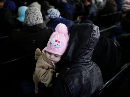 Syrian families waits to register at the United Nations High Commissioner for Refugees headquarters, in Beirut, Lebanon, Monday, Jan. 30, 2017. By executive order, U.S. President Donald Trump imposed a 90-day ban, Friday, that affects travel to the U.S. by citizens of Iraq, Syria, Iran, Sudan, Libya, Somalia and Yemen and puts an indefinite hold on a program resettling Syrian refugees. (AP Photo/Hassan Ammar)