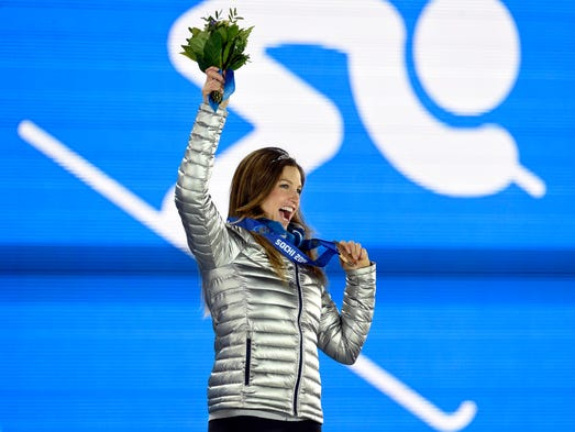 Julia Mancuso (USA) reacts after receiving her bronze medal during the medal ceremony for the ladies' alpine skiing super combined in the Sochi 2014 Olympic Winter Games at the Medals Plaza.
