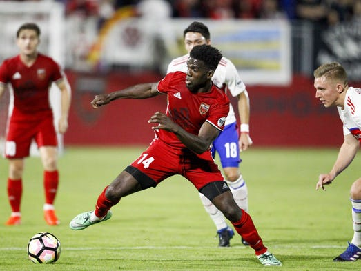 Phoenix Rising FC forward Jason Johnson (14) dribbles