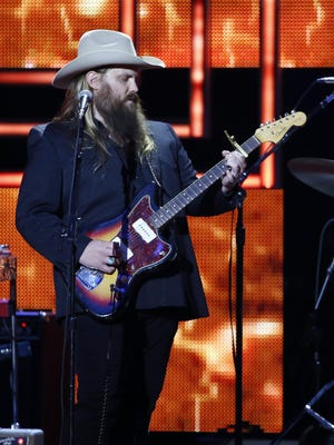 In this Dec. 2, 2015, photo, Chris Stapleton performs at the 2015 Artists of the Year Show at Schermerhorn Symphony Center in Nashville, Tenn. Chris Stapleton dominated at the Grammys and the Country Music Association Awards, but will he repeat at the Academy of Country Music Awards on Sunday, April 3, 2016? Stapleton is the leading nominee with seven, but hes not up for the top award: entertainer of the year. Instead, he will compete for album, song and male vocalist of the year. He won new male vocalist of the year in an early announcement.